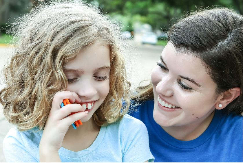 Girl with Autism and carer